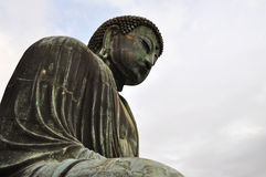 The Great Buddha. Side view of the statue of the Giant Buddha in Kamakura, Japan from ground level royalty free stock image