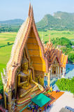 Great buddha statue with church Stock Images