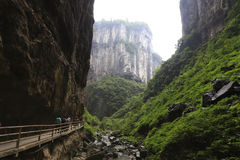 Great canyon. Tourists walk in the wooden road, water, sparkling and rock, trees and vegetation Stock Photography