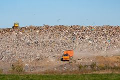 Great Cars And A Tractor On The Background Of The Landfill With A Mountain Royalty Free Stock Photo