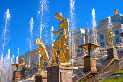 Great cascade. It consists of many fountains and is decorated with bronze gilt sculptures. Petergof, St. Petersburg. Great cascade. It consists of many fountains Stock Photo