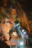 Great cave, Grotta di Su Mannau, Fluminimaggiore, Sardinia. Fluminimaggiore, Sardinia, Italy - August 07, 2018: Tourists visit the cave of `Su Mannau` stock photography