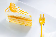 Orange cheesecake dish. Great cheese cake with slice of orange on top prepared to eat with fork Stock Image