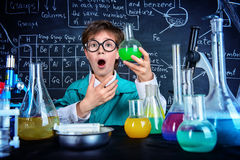 Great chemical discovery. Smart boy scientist making chemical experiments in the laboratory. Educational concept. Discovery stock photos