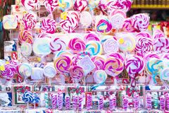 Colorful lollipops on stick for sale in shop window. Great choice of colorful lollipops on stick for sale in shop window Stock Photo