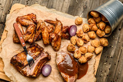 Great choice of grill snacks to beer on wooden background Stock Photo