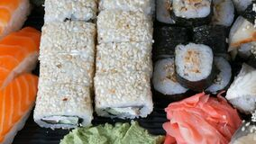 Great choice Variety of sushi roll, nigiri, maki, Gunkan with salmon, eel, shrimps, Philadelphia cheese and other. National Japanese cuisine close up view stock video