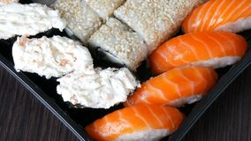 Great choice Variety of sushi roll, nigiri, maki, Gunkan with salmon, eel, shrimps, Philadelphia cheese and other. National Japanese cuisine close up view stock footage