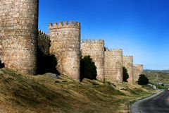 Great city wall in Avila, Spain. Famous  medieval city walls, that were constructed of brown granite in 1090 Royalty Free Stock Photography