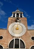 Great Clock of the church with the golden needle in Venice. Stock Photo
