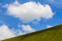 A great cloud drifts over the Brecon Beacons in South Wales, Britain royalty free stock photos
