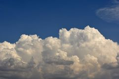 Great clouds and splendid blue  sky. In a spring day at morning Stock Image
