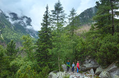 Great Cold Valley summer view (High Tatras, Slovakia). Family walking in Great Cold Valley (Velka Studena dolina). Summer cloudy view. High Tatras, Slovakia stock image
