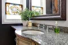 Great combination of marble, rustic framed mirror and mosaic win Stock Images