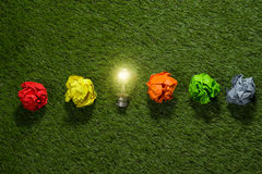 Great concept with crumpled office paper and light bulb standing on the table stock images