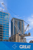 Great Condos. Construction site with a crane and buildings on a background Royalty Free Stock Images