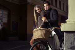 Great couple riding oldfashion bicycle Royalty Free Stock Photos