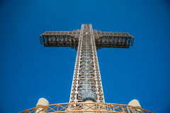 Great cross monument of steel structure against blue sky, Millennium Cross. Stock Photo