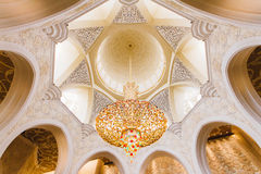 Great Crystal Chandelier at the Ceiling of Sheikh Zayed Mosque, The Great Marble Grand Mosque at Abu Dhabi, UAE Stock Photo