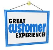 Great Customer Experience Words Store Business Company Sign. Great Customer Experience words on a hanging sign in the window of a store, company or business Royalty Free Stock Photo