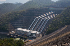 Great dam to generate electricity in the misty valley of Thailan Stock Image