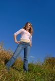 Great Day. Female standing on a hill against the sky Royalty Free Stock Photography