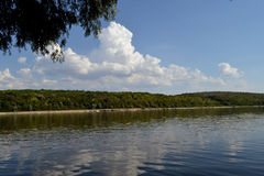 Great day on the river Danube. Blue Sky filled with huge clouds are reflected in the waters of the Danube royalty free stock photography