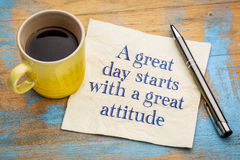 A great day starts with a good attitude. Handwriting on a napkin with a cup of espresso coffee stock photos