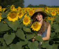 A great day to be alive. Beautiful girl, pretty smile, sunflowers and sunshine Royalty Free Stock Image