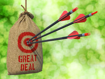Great Deal - Arrows Hit in Red Target. Great Deal - Three Arrows Hit in Red Target on a Hanging Sack on Green Bokeh Background stock photo