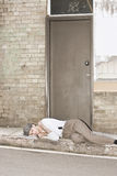 Great Depression Eviction. A Newly Evicted Homeless Man Sleeps On The Kerbside: A Victim Of The 1930�s Great Depression Royalty Free Stock Photos
