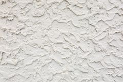 Heavy Thick Sand Cement Stucco Texture on Wall. A great display of very heavy sloppy cement stucco on a wall. A great texture background for graphic design, web royalty free stock photos