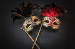 Great ditailed view of old artistic  theatrical colorful masks on dark grey background. Amazing beautiful closeup view of old theatrical colorful masks on dark Stock Image