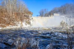 Great Falls with a rainbow in winter. Great Falls waterfall flowing over a dam into the Housatonic River Royalty Free Stock Photos