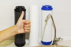 Great filters to purify your drinking water an image isolated in the kitchen interior.  Stock Photos