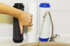 Great filters to purify your drinking water an image isolated in the kitchen interior.  Royalty Free Stock Photography
