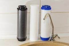 Great filters to purify your drinking water an image isolated in the kitchen interior.  Royalty Free Stock Images