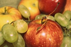 Apples and green grapes on fabric royalty free stock photo