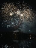 Bucharest-Titan Park -Fireworks New Year 2018. Great fireworks show above the lake in Titan Park, we can see the reflection in the water Royalty Free Stock Photos