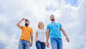 The great fit for the day off. Young people in casual style on cloudy sky. Group of people in casual wear. Fashion. People look casual in summer outfit. Pretty royalty free stock images