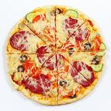 Great flavorful pizza sliced into chunks on white background Stock Photography