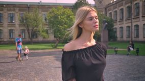 Great free walk of caucasian woman looking straight , blowing wind, sunny perfect weather in the park.  stock video