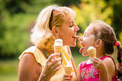 Great fun - eating icecream together Stock Image