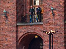 Great gala. Men playing trumpets in Stockholm city hall. 12-05-2014 royalty free stock image