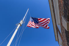 Great garrison flag at Ft. McHenry. The great garrison flag, a replica of the 1812 flag, flies at Fort McHenry in Baltimore, Maryland Royalty Free Stock Image