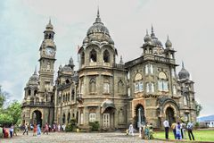 The New Palace!. The great giant monument which is surrounded by visitors all around is a mark of great history. New Palace, Kolhapur is a palace situated in Royalty Free Stock Photography