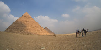 Great Giza pyramids in Egypt with camels, panoramic view Stock Image