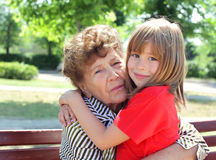 Great-granddaughter with great-grandmother. Embracing Stock Image