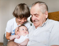 Great grandfather with grandchildren Stock Photography