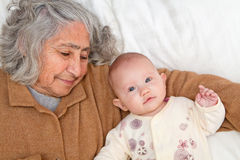 Great Grandma Laying Down With Baby Royalty Free Stock Photography